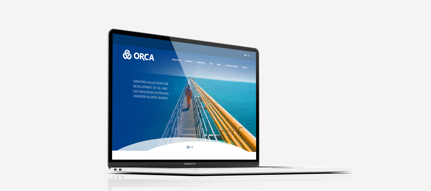 A macbook showing the home page of Orca Exploration