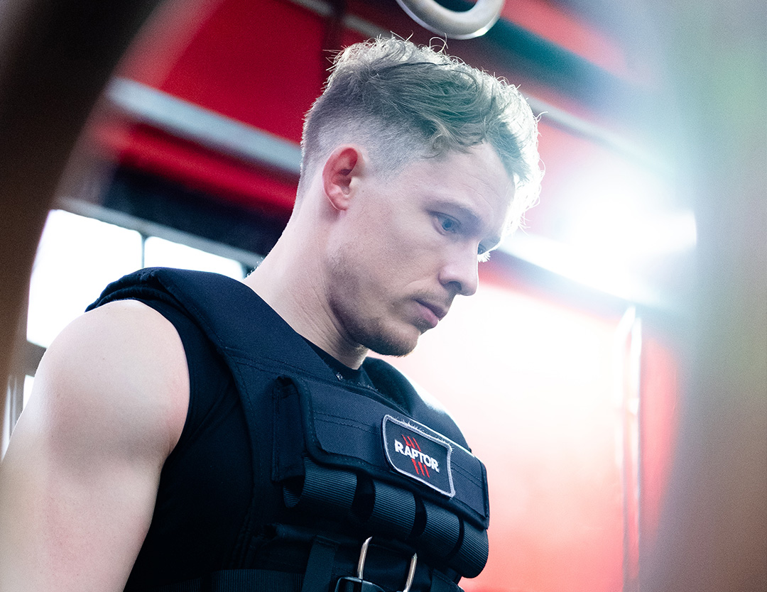 A front shot of a model in the weight vest