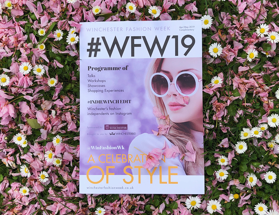 The front cover of the WFW 2019 magazine on a bed of flowers