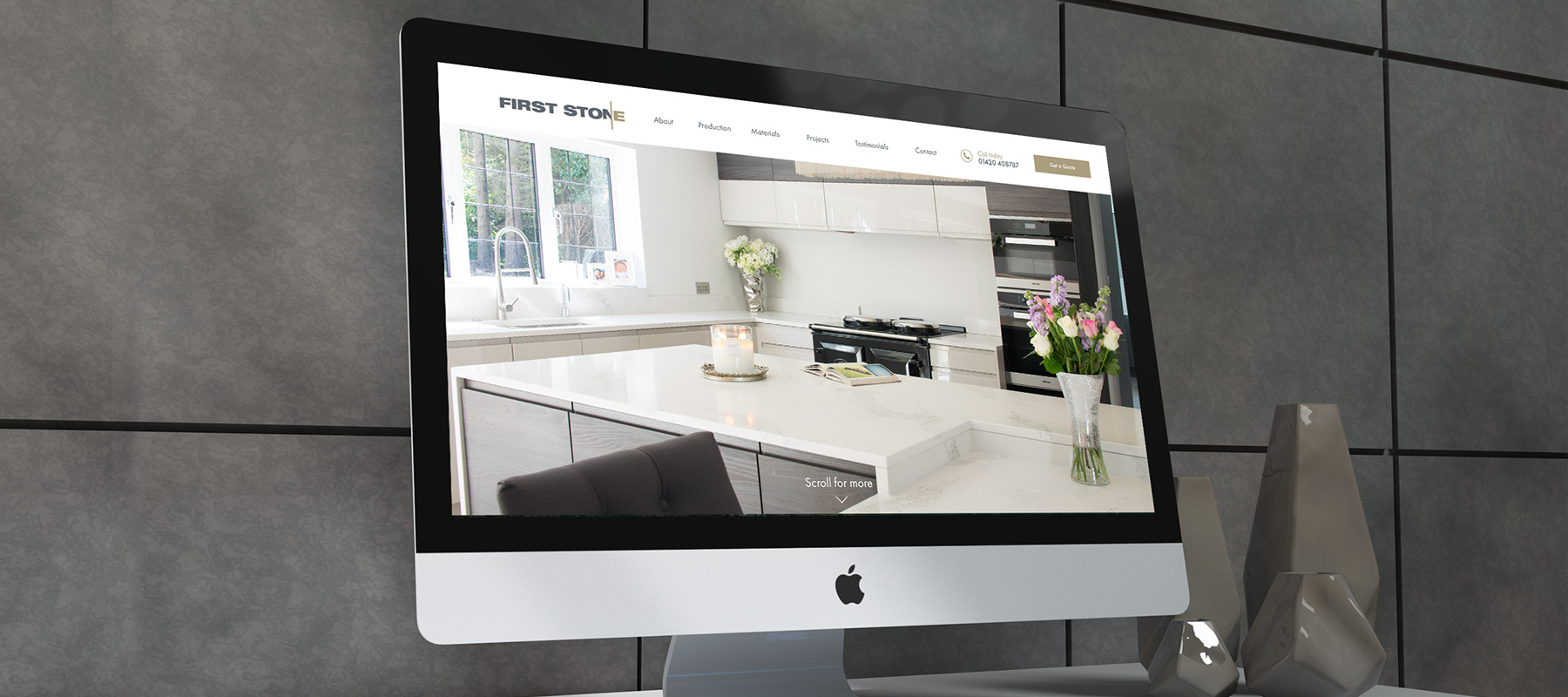 A iMac showing the homepage of First Stone Worktops